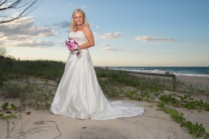 Blonde bride on the beach at sunset